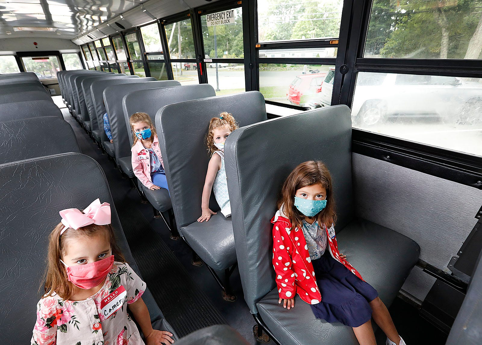 New kindergarten students at the Chandler School get familiar with how to ride the bus, one student per seat on Tuesday, Sept. 8, 2020.