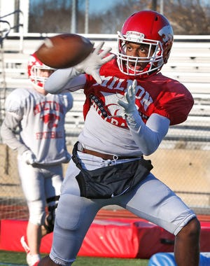 Milton High wide receiver Andrew Lynch runs a drill at practice on Monday, March 8, 2021. The Wildcats are preparing for Friday's season opener against Weymouth.