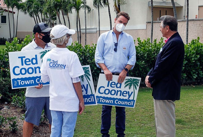 Town Council candidate Ted Cooney, second right, chats with a voter outside the Morton and Barbara Mandel Recreation Center during the town's general election Tuesday. Cooney won the Group 1 seat over opponent Candace Rojas with 81% of the vote.