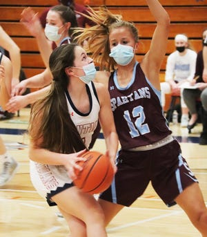 Pontiac senior Tristina Einhaus, shown here driving to the basket against St. Joseph-Ogden  earlier this season, scored 14 points to tie for team honors in the Indians' 57-43 win over Rantoul Monday at PTHS.