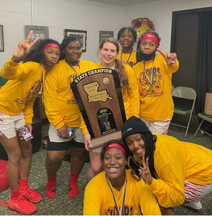 The East Iberville Lady Tigers celebrate after winning the Class 1A non-select state title in a win over Northwood-Lena on March 4 in Hammond.