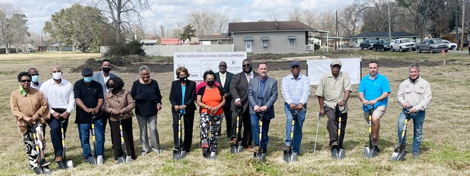 The New Horizons Community Development Corp. broke ground for two duplexes it will build on the corner of Baytown Street and Iron Farm Road.