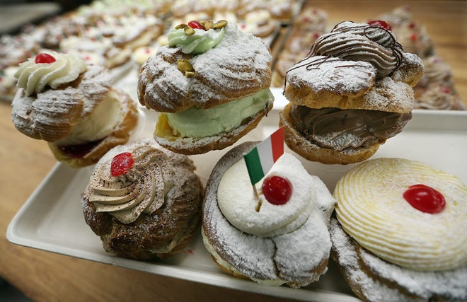 The Original Italian Bakery in Johnston has six filling flavors for zeppole including (clockwise from top left) raspberry and whipped cream, pistachio, chocolate cream, traditional pastry cream, ricotta cheese and Irish Cream.