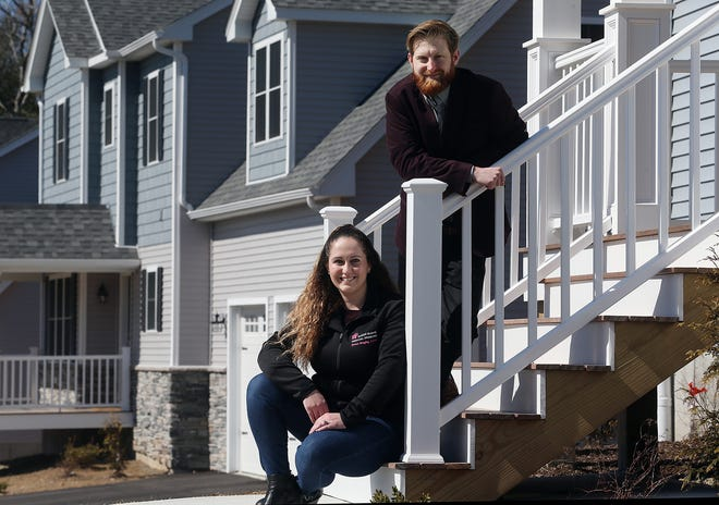"""Sara Larrabee and fiance Nick Cannata at their new home in Coventry, which they built during the pandemic. """"We were ready to sign a contract with the builder pretty much the day before the world shut down,"""" said Larrabee."""