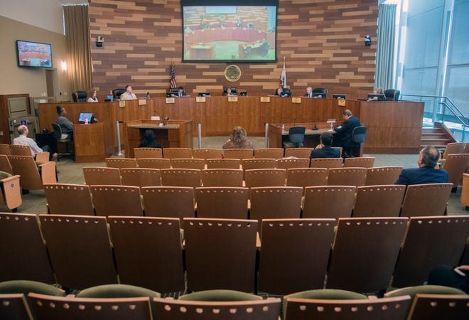 San Joaquin County Board of Supervisors hold a meeting about the COVID-19 virus at the San Joaquin County administration building March 17, 2020, in downtown Stockton.
