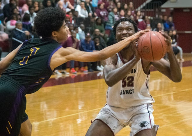 (3/5/20)Weston Ranch's Gavin Wilburn, right, goes to the hoop on Oakland Tech's Robel Zemmo during the quarter final game of the CIF State Northern California Regional Championships at Weston Ranch High School in Stockton. [CLIFFORD OTO/THE RECORD]
