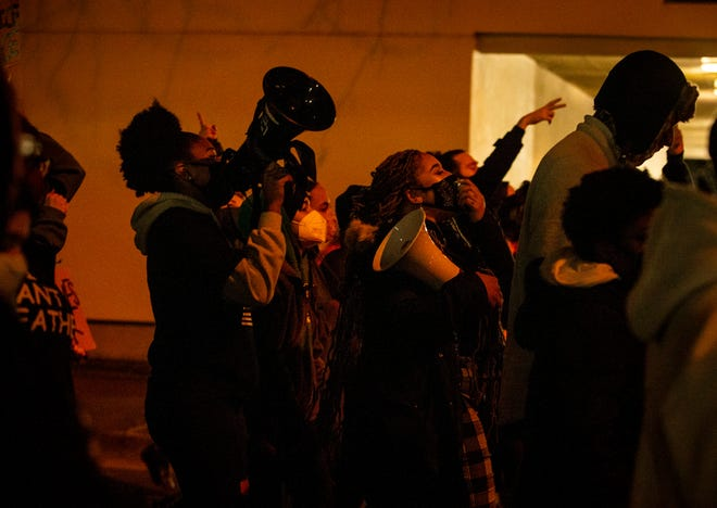 Two women lead with protest chants and song through downtown Eugene on Monday, March 7, 2021. Black Unity filed a federal civil lawsuit against the City of Springfield, Springfield Police Department, Chief Richard Lewis and other individual officers earlier in the day.