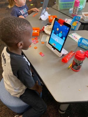 Students in Tina Glymph's class works with the Osmo learning tool with their numbers.