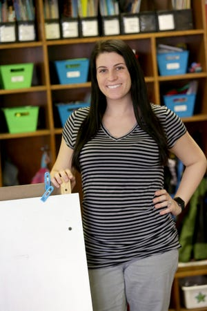 Brooke DeWitt is The Massillon Independent's Walsh University Teacher of the Month for March.