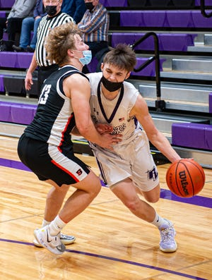 Rockford Lutheran's Zach Derus drives past Byron's Chandler Binkley during the  BNC conference semifinal game at Lutheran on Monday, March 8, 2021. Lutheran pulled away for a 66-44 win.