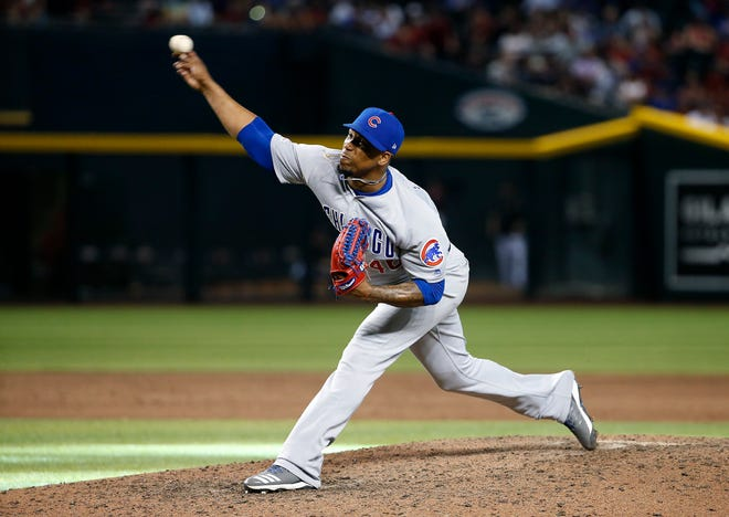 Chicago Cubs pitcher Pedro Strop throws against the Arizona Diamondbacks during the ninth inning of a baseball game in Phoenix, in this Sunday, April 28, 2019, file photo. Strop returned to Cubs training camp this week after violating COVID-19 protocols.