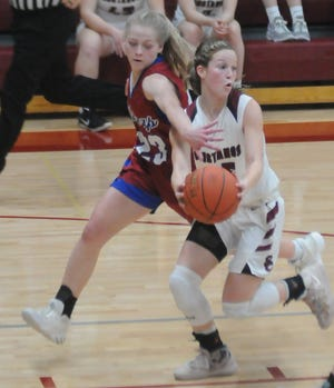 Seaman's Taylin Stallbaumer (23) tries to defend Salina Central's Aubrie Kierscht (35) on a breakaway during the second half of a Class 5A state quarterfinal Monday at Salina Central.
