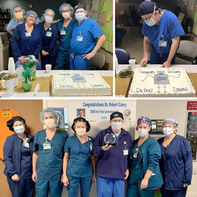 Dr. Robert Carey and his team celebrate his recognition for performing over 2,000 robotic surgeries at Sarasota Memorial Hospital.
