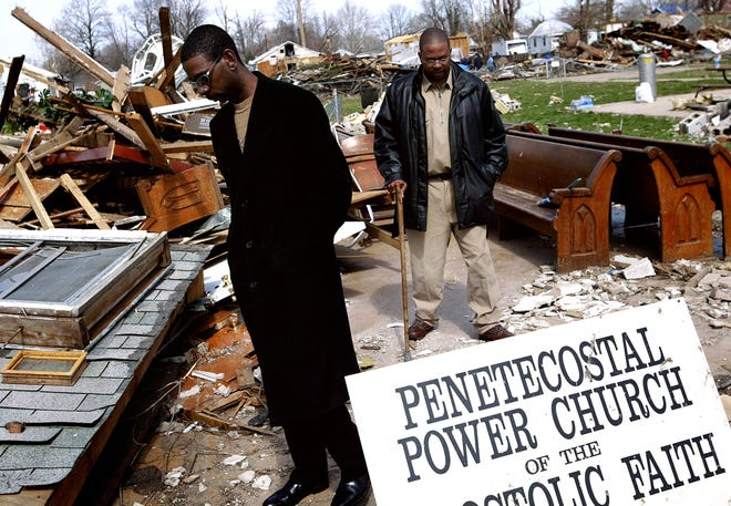 Parishioners Reggie Britton, left, and Randel Britton survey the remains of their church after a tornado destroyed it on March 12, 2006.