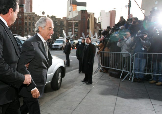 Bernard Madoff arrives at federal court in New York, in this March 12, 2009, photo. Madoff pleaded guilty to charges that he engineered one of the largest investment scams in U.S. history.