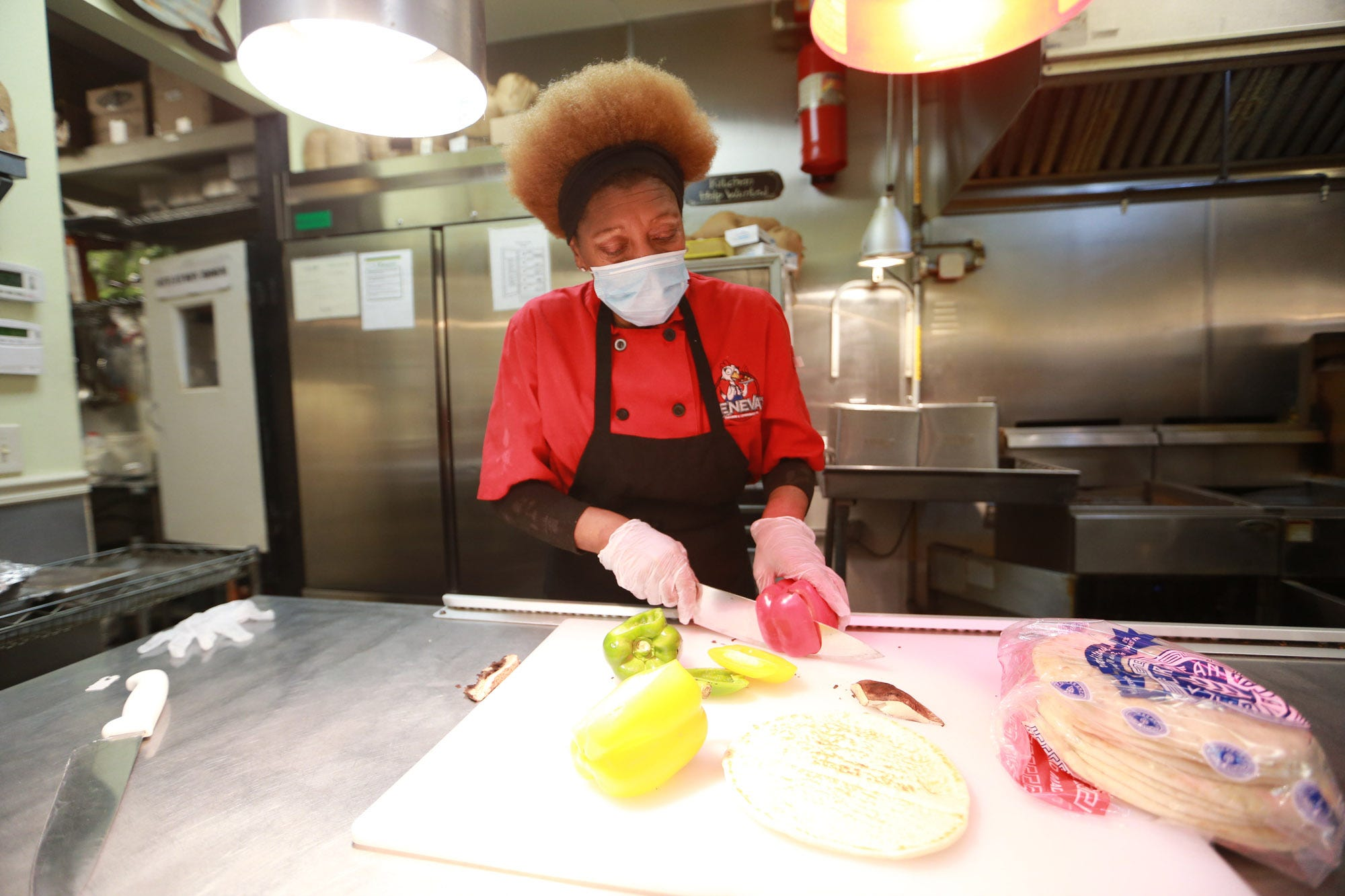 Geneva Wade slices veggies at Geneva's Famous Chicken and Cornbread Co. located in the Victory Square Shopping Center in Savannah.