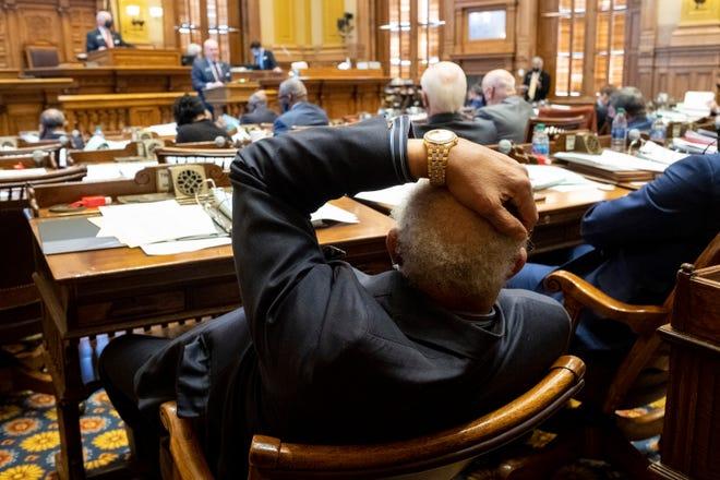 Georgia State Sen. David Lucas (D-Macon) listens to debate on Senate Bill 241, which would changes Georgia's voting laws, on Monday.  (AP Photo/Ben Gray)