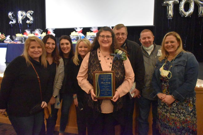 Shawnee 2021 Teacher of the Year Sandra Bradley with her family and friends after winning the title.