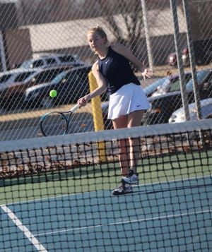 Shawnee's No. 1 singles player Olivia Stobbe makes the return during the Shawnee Invitational on Monday.