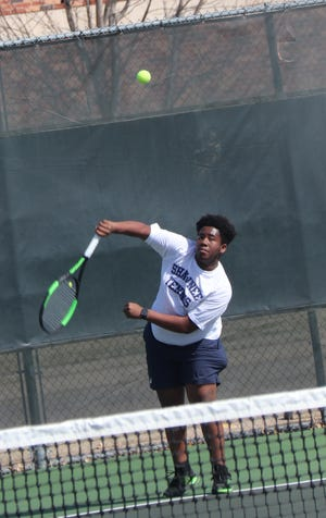 Shawnee's No. 2 singles player Dymire Jones delivers a serve during the Shawnee Invitational on Monday.