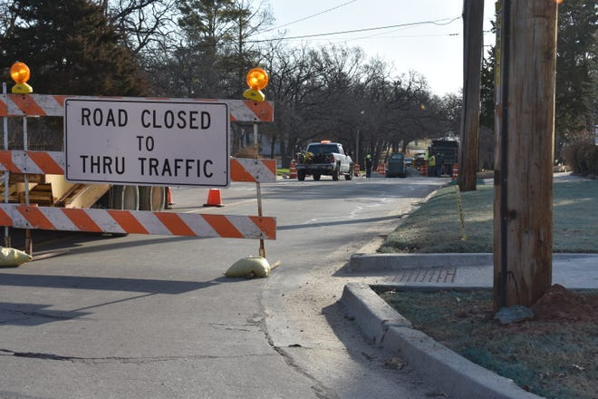 Shawnee Water Department crews work on a main break on Independence Street, just east of North Broadway.