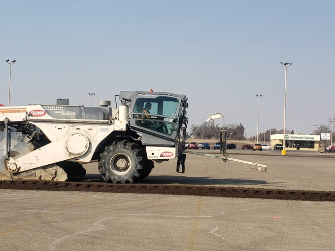 Equipment was set up at Midland Plaza shopping center Tuesday to build an Arby's restaurant in Kewanee. Here, a truck grinds the asphalt to turn into gravel for the project.