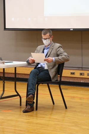 Art Ebert, superintendent at Sturgis Public Schools, examines his notes Monday during the board of education meeting.