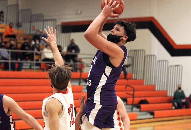 Isaiah Moore avoids contact while going up for two points for Three Rivers on Monday night.