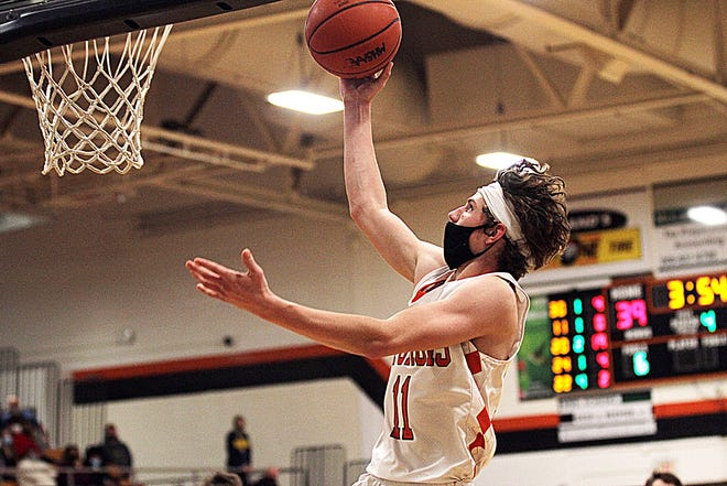 Hayden Goodman of Sturgis glides in for a layup against Three Rivers on Monday night.