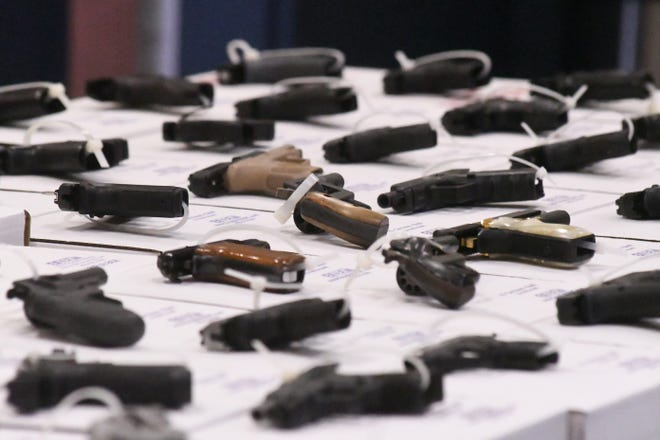 The Wilmington Police Department held a press conference Monday March 8, 2021 to discuss gun violence and two recent shooting incidents in the New Hanover County area. The guns that were on display were recovered in just the past 30 days. [KEN BLEVINS/STARNEWS]