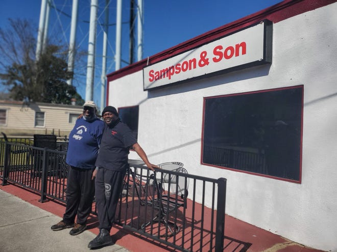 Elton Sampson and his son Lester McKeithan are pictured in front of their restaurant at 806 Queen Street in New Bern. [Tina Adkins, Sun Journal staff]
