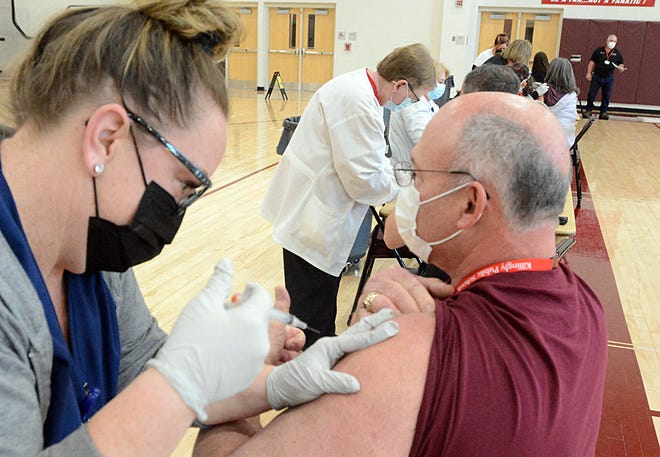 Robert Angeli, Killingly superintendent of schools, gets his Johnson & Johnson COVID-19 vaccine from Jessica Provencher, R. N. at Day Kimball Hospital in Putnam Tuesday as 350 shots were given out to Killingly Public School employees at Killingly High School. See video and more photos at NorwichBulletin.com [John Shishmanian/ NorwichBulletin.com]