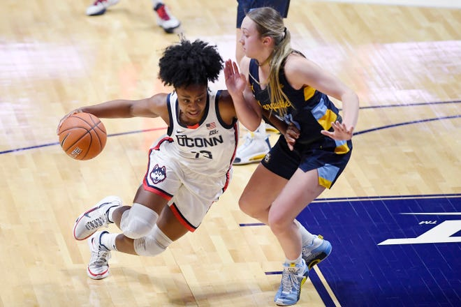 UConn's Christyn Williams dribbles as Marquette's Jordan King, right, defends during the Big East championship game at Mohegan Sun Arena in Uncasville.