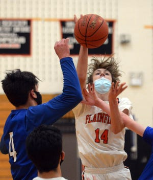 Plainfield's Ryan Weldy shoots over Putnam's Johnathan Carita during the Panthers' win last week at Plainfield.