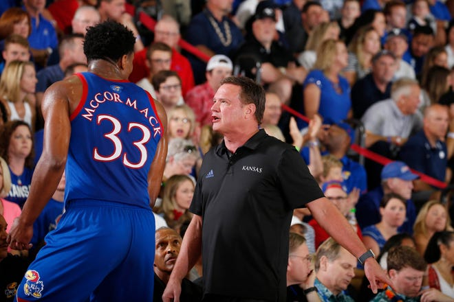 "Kansas basketball coach Bill Self, right, announced Tuesday that the No. 11-ranked Jayhawks will be without starting forward David McCormack, left, and reserve combo guard Tristan Enaruna at this week's Big 12 Tournament at T-Mobile Center in Kansas City, Mo. McCormack and Enaruna have ""semi-recently"" entered COVID-19 protocol, Self said."