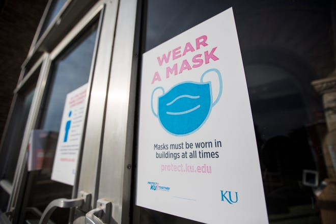 A sign reminds visitors to the KU Memorial Union that they must wear masks while inside University of Kansas buildings.
