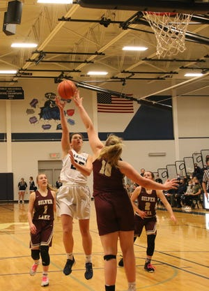 Sabetha's Melinna Schumann goes up for a shot over Silver Lake's Makenzie McDaniel during Monday's Class 3A girls state quarterfinal game at Sabetha. Schumann scored nine, but the Bluejay defense carried the night in a 47-28 Sabetha win.