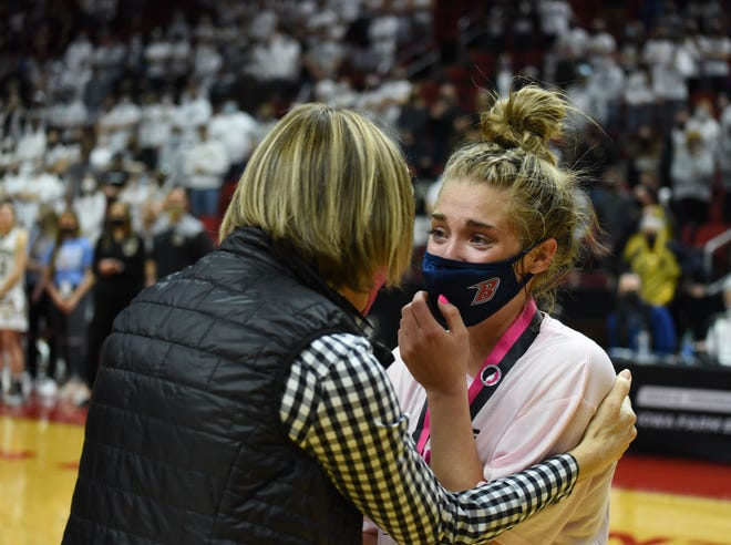 Ballard's Molly Ihle receives her Class 4A all-tournament team medal at the girls' state basketball tournament Saturday in Des Moines. Ihle was named team captain and teammate Brooke Loewe was also chosen to the team after the two helped Ballard claim its second state championship.