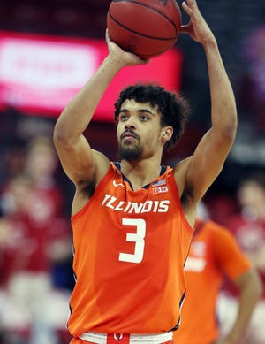 Former Holy Cross standout Jacob Grandison attempts a free throw for Illinois last month in a game at Wisconsin.