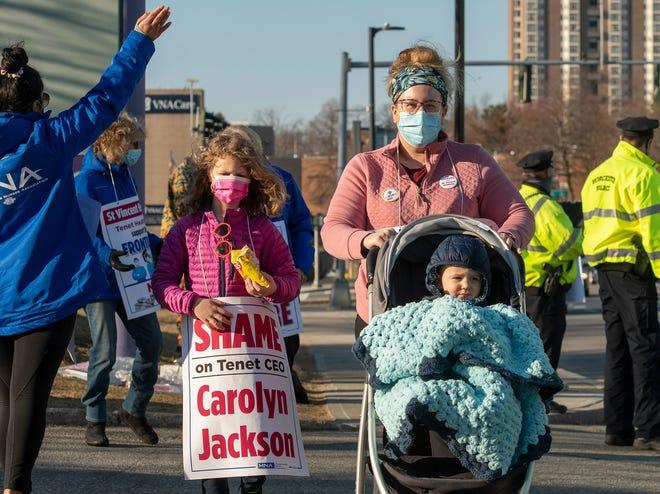 St. Vincent Hospital nurse Katie Aufiere of West Boylston walks the picket line Tuesday with her children Lauren, 8, and Joshua, 21 months.