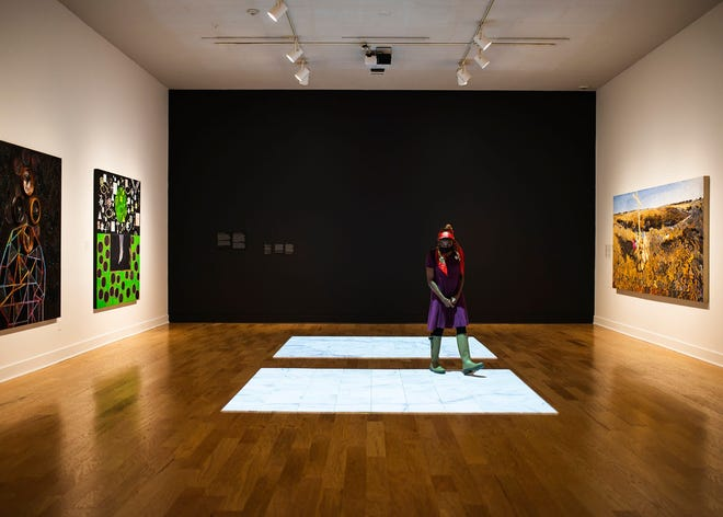 At Fitchburg Art Museum last July, Emmanuella Demosthenes had one of the galleries to herself after the museum reopened. The pandemic forced it to close, again, in December, but FAM plans to open to the public, again, at the end of March.