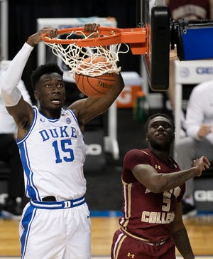 Mark Williams dunks the ball during Duke's 86-51 win over Boston College in the first round of the ACC Tournament in Greensboro.
