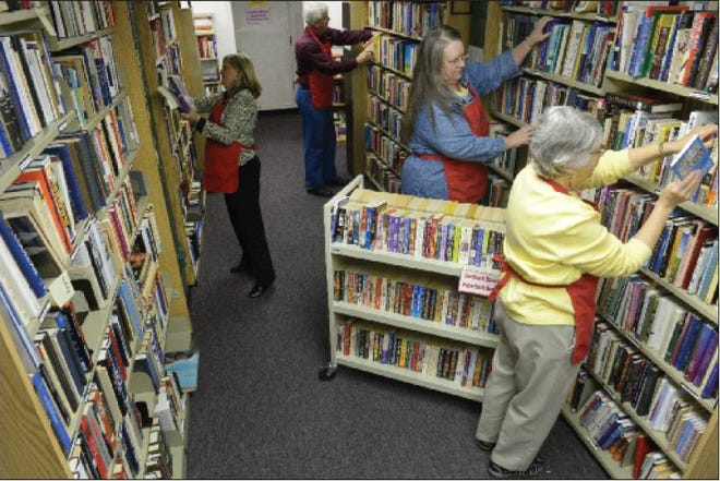 Volunteers preparing for the spring Friends of the Alamance County Libraries Book Sale in 2014