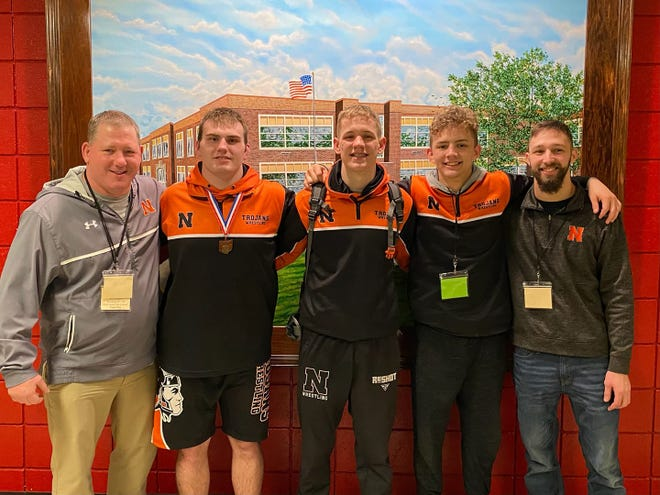Newcomerstown's Jordan Sanders, Coltin Meek and Logan Hursey are sandwiched between assistant Dave Henry and head coach Alan Hayhurst after last weekend's District meet at Coshocton.