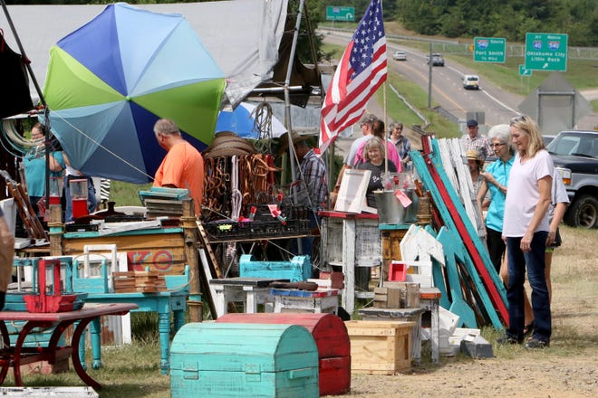 Shoppers spend an afternoon making their way along Highway 64 outside of Van Buren in August 2018 during the annual Bargains Galore on 64 area-wide yard sale. The event returns Aug. 12-14 this year after a lapse in 2020 due to the COVID-19 pandemic. [Times Record File Photo]
