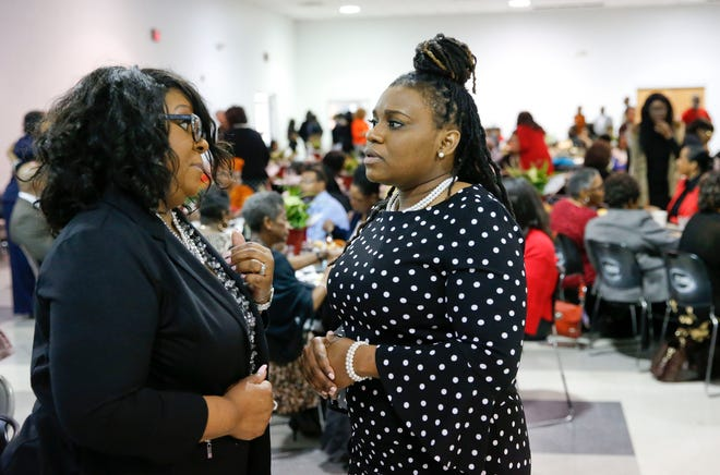 Tuscaloosa City Councilors Sonya McKinstry, left, and Raevan Howard speak together during the Honoring Our Trailblazers breakfast at the McDonald Hughes Center on Feb. 23, 2019. McKinstry is challenging the outcome of the District 7 race that saw her fall to challenger Cassius Lanier. Howard was declared the winner of her District 2 race on Tuesday over three other challengers. [Staff file photo/Gary Cosby Jr.]