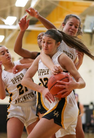 Upper Arlington's Clara Gallapoo grabs a rebound from teammates Alyssa Gest (left) and Kate Leach and Pickerington North's Mayson Bates earlier this season. Gallapoo, who averaged 4.4 points, was one of two seniors on the team.