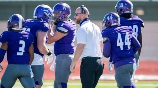 Southwestern Assemblies of God University head coach Ryan Smith greets his players as they come off the field during Saturday's 27-20 victory over Lyon University in Batesville, Ark.