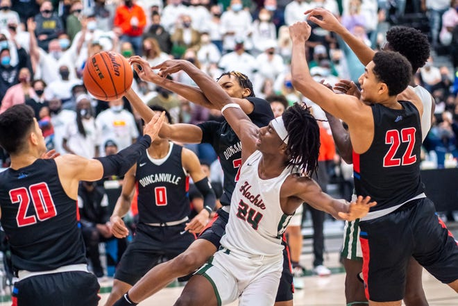 Waxahachie senior Montez Young Jr. (24) fouls Duncanville's Cameron Bernes during Friday night's Class 6A Region II boys' basketball championship game at Mike Turner Gymnasium. The Runnin' Indians' season ended in a 70-65 loss.