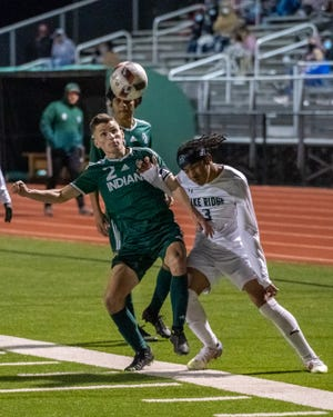 Waxahachie's Luke Villarreal (2) looks in a pass during a January home game against Mansfield Lake Ridge. The Indians clinched a playoff berth Monday night with a 5-0 home whitewash of Waco Midway.